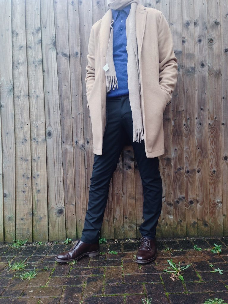 Camel overcoat with tapered fitting smart trousers, a cashmere scarf and merino polo shirt.